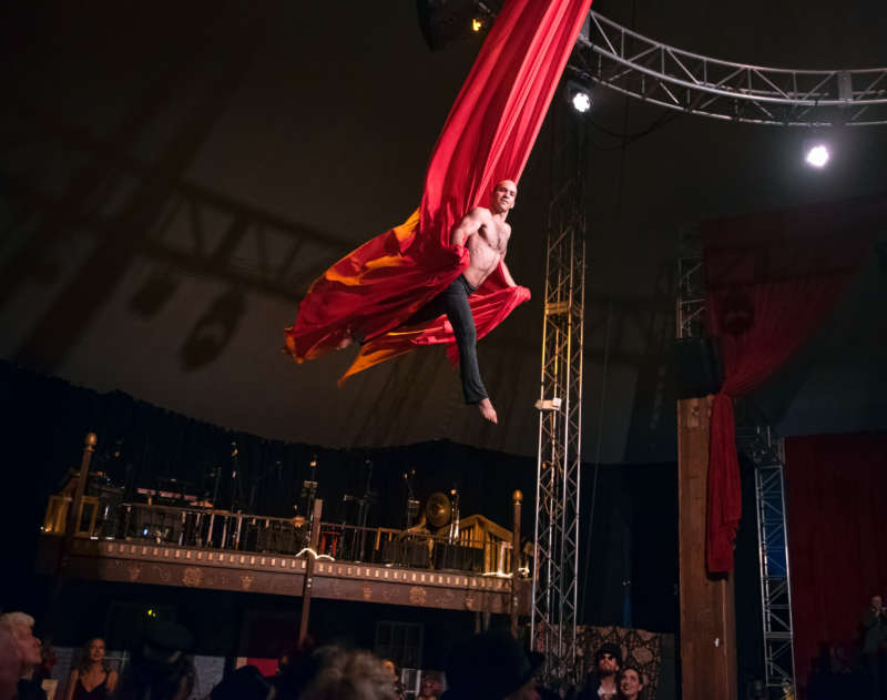Vau de Vire Society's Gemiah performs aerial silks during The Soiled Dove dinner theater