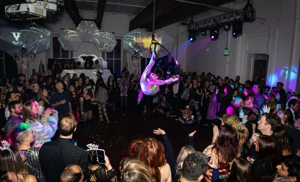 Stephanie Bailey of the Vau de Vire Society performs on a lyra at New Bohemia NYE 2020